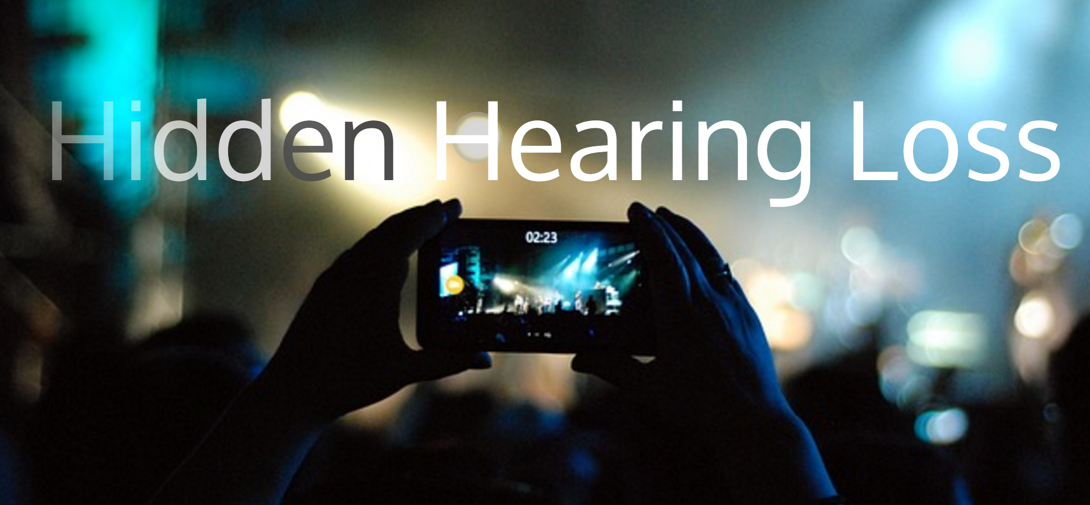 hidden hearing loss person with IPhone recording concert