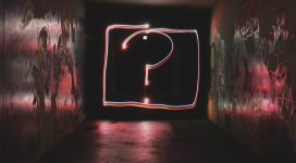 question mark drawn in neon lights