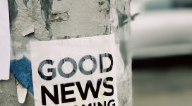 Good News is Coming poster on a pole positive words